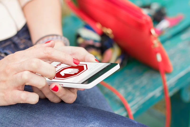 Woman on mobile phone, showing an egregious ad.
