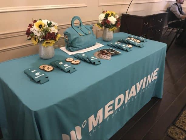 The Mediavine raffle table, displaying the teal camera bag.