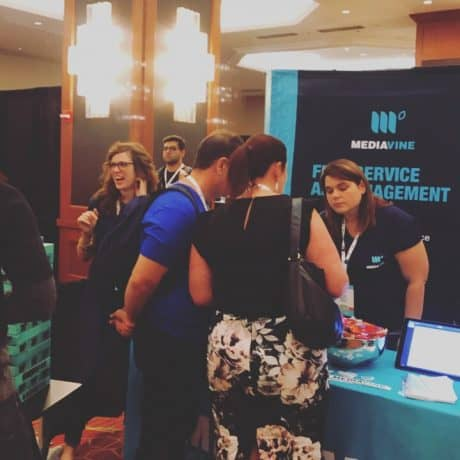 Amber Bracegirdle, Mediavine cofounder, speaking with FinCon attendees at the Mediavine booth.
