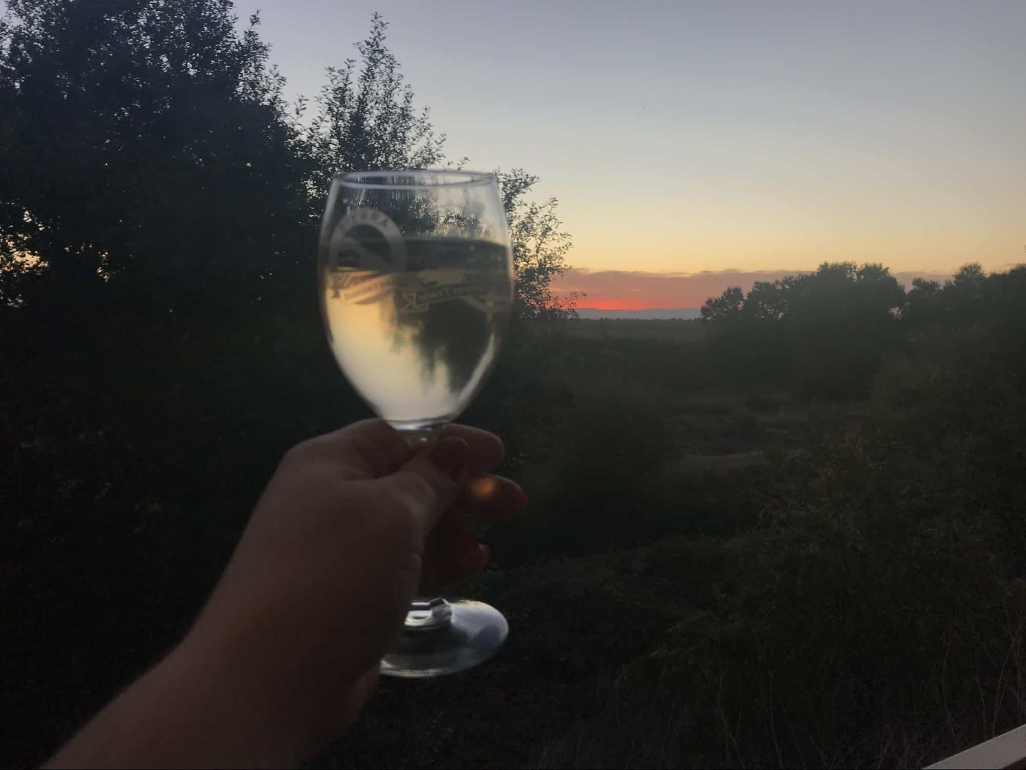 A glass of wine to toast a beautiful sunset.