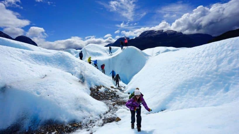 Kristin Addis hikes over snow and ice.