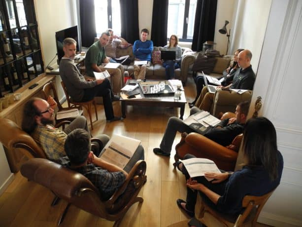 The Agathon team meeting in a more casual living room type setting.