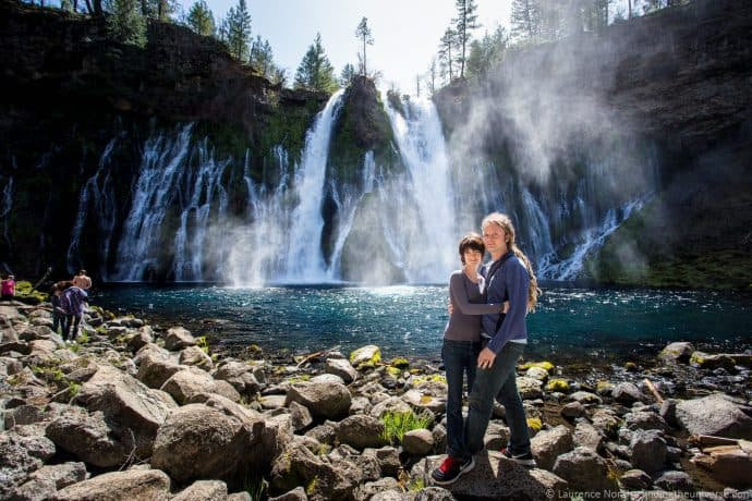 Laurence Norah and his wife, Jessica, stand in front of a waterfall.