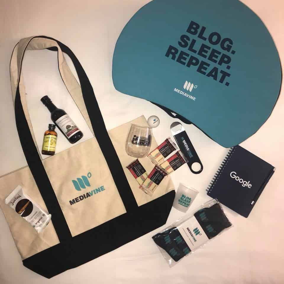 MVCon swag bag, filled with a lapdesk, wine, cheese, and other goodies.