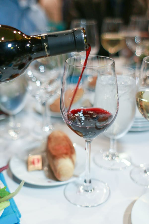 Wine being poured into a glass.