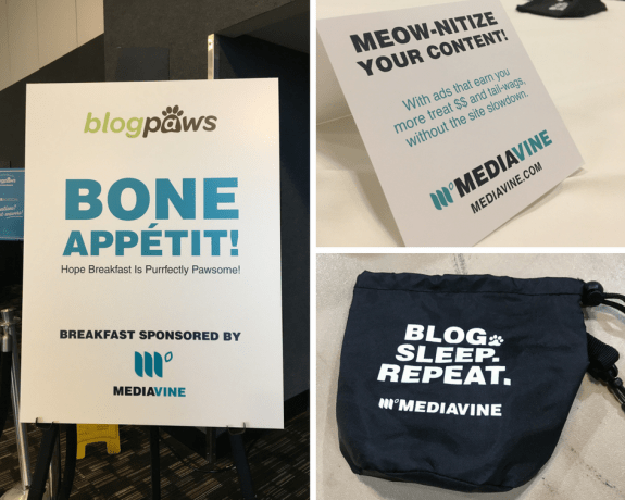 "Mediavine signage from BlogPaws, complete with puns. A sign for the sponsored breakfast reads ""Bone Appetit"", while a card encourages people to ""Meow-nitize"" their content. In the bottom right, a Mediavine pet treat bag reads ""Blog. Sleep. Repeat."""