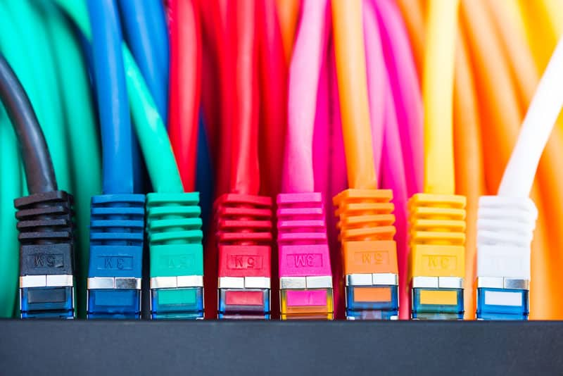 A jumble of colorful Ethernet wires.