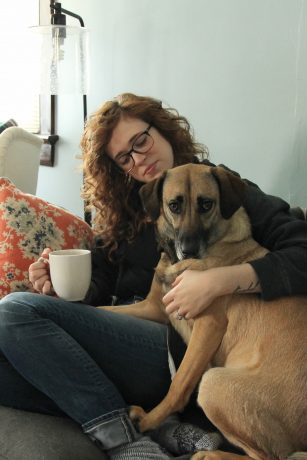 Stephie enjoying a cup of coffee with her dog, Anya.