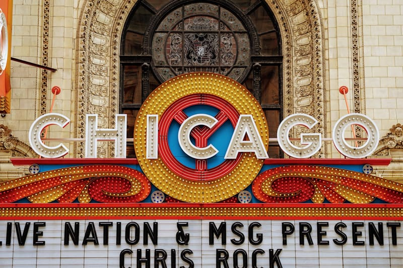 """Theater lighting up the word """"Chicago""""."""