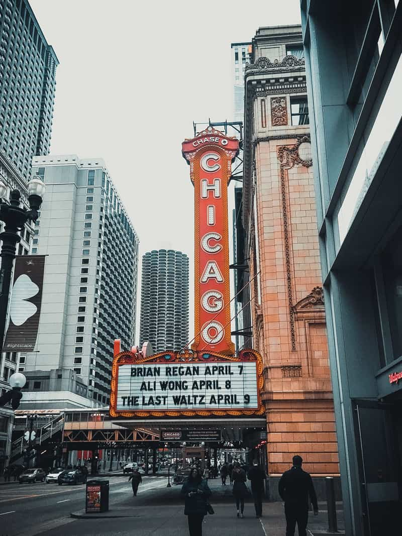 """A large, lit-up sign reading """"Chicago"""" over a theatre entrance."""
