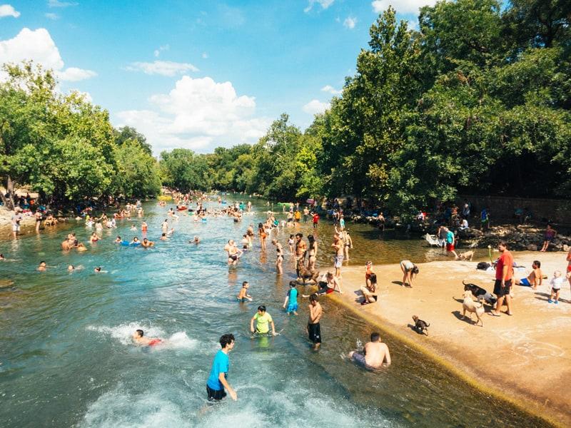 P gather to swim in Austin, TX.