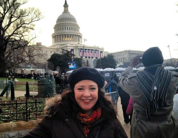 Alison Gary stands in front of the US Capitol Grounds.