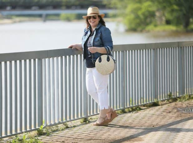 Alison Gary stands at a railing, overlooking a river.