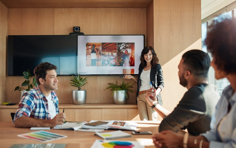 A group of people speaking in a conference room.