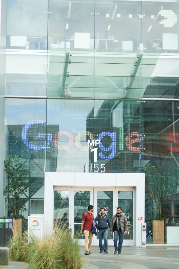 Three men walking out of Google Headquarters in Mountain View, CA.