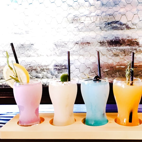 A lineup of fancy cocktails.