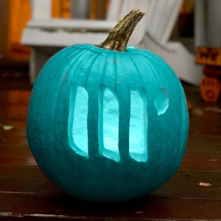 A teal pumpkin carved with the Mediavine logo.