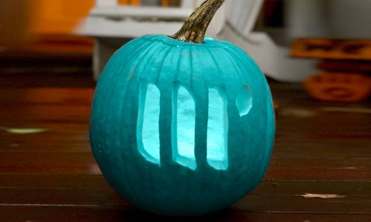 teal pumpkin with mediavine logo carved into it