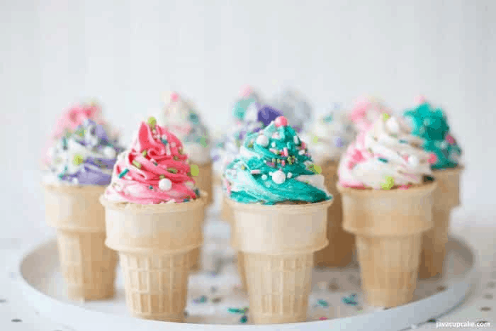 Cupcakes baked in ice cream cones, topped with colorful frosting.