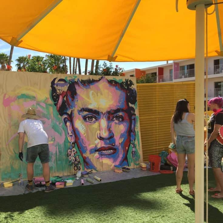 An artist painting a mural.