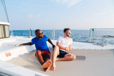 yaya and lloyd sitting on a boat