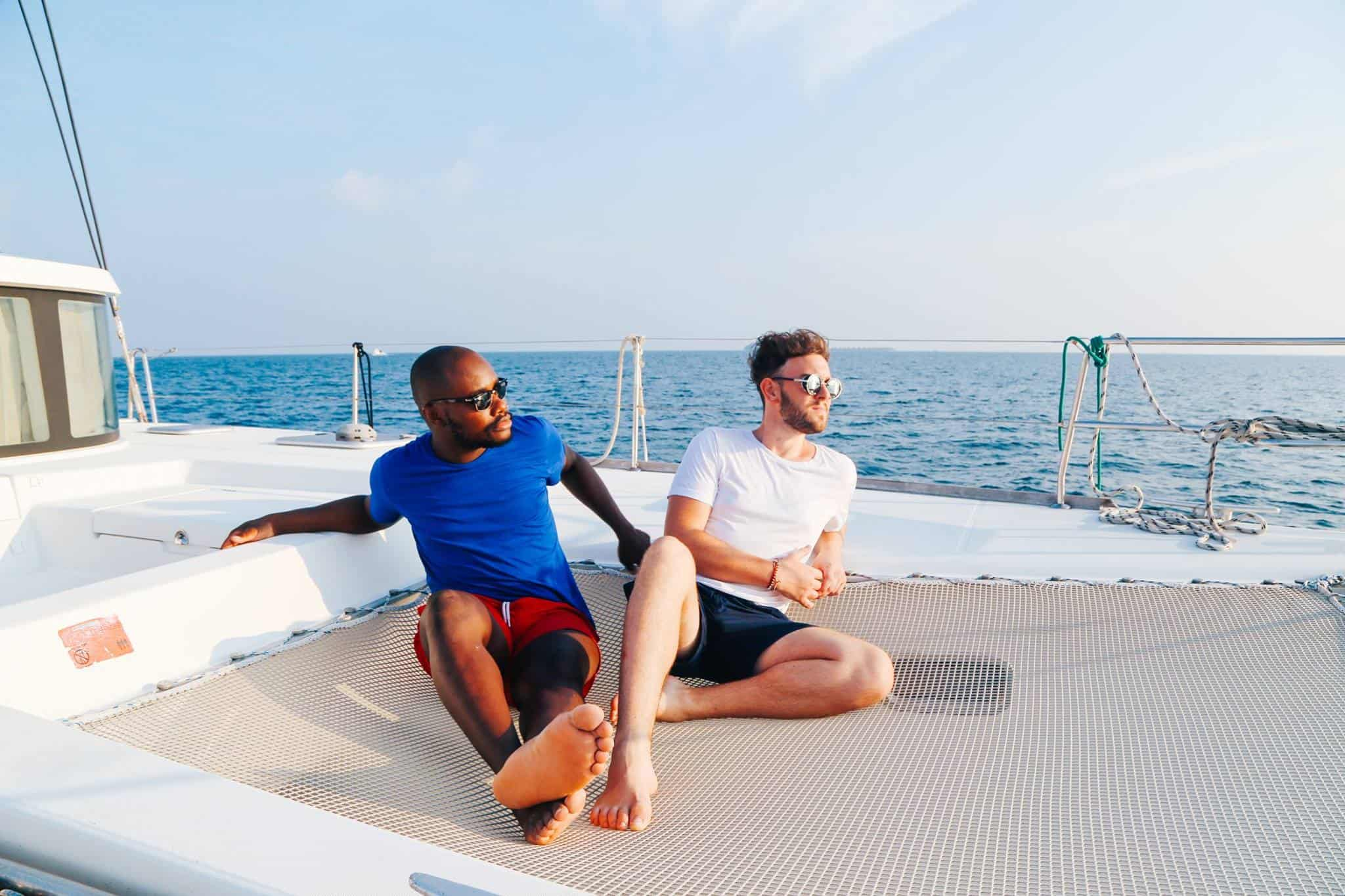 yaya and lloyd sitting on a boat