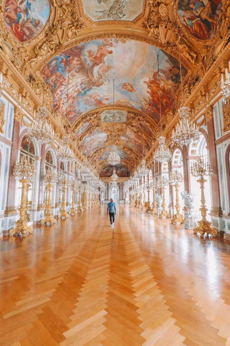 Yaya walking through the halls of Herrenchiemsee Palace in Germany.