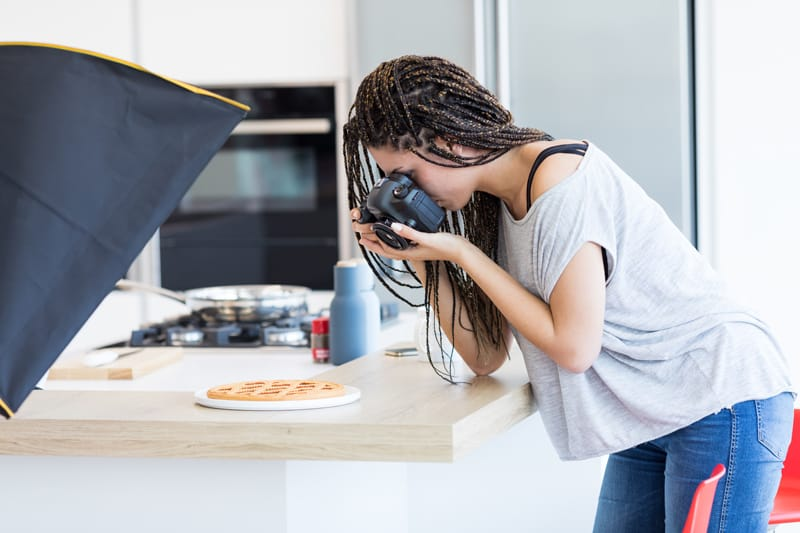 woman taking photos of food