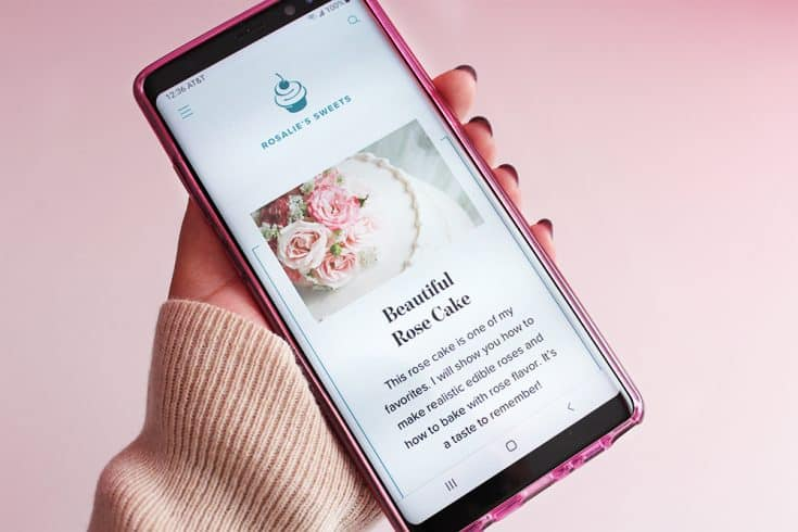 A smart phone displaying a recipe card for a Beautiful Rose Cake.
