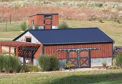 A red and navy painted barn.