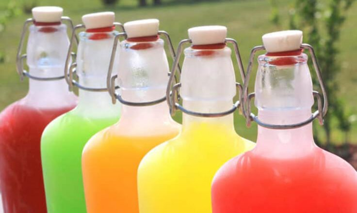 clear glass bottles filled with the colors of skittles