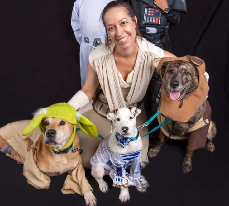 Cynthia and her dogs dressed in matching Star Wars costumes.