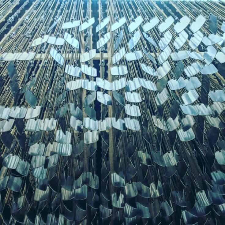 An art installation made of hanging dog tags.