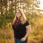 trista standing in a grass field