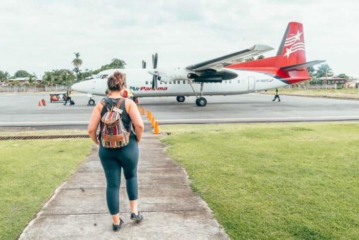 Lia Garcia walks towards an AirPanama airplane.