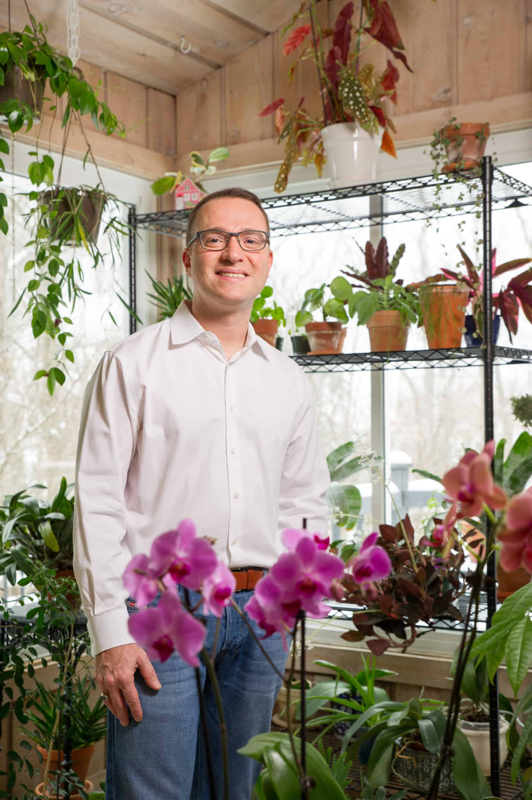 Raffaele Di Lallo of Ohio Tropics with houseplants