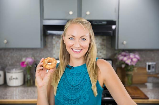 samantha merritt holding a donut