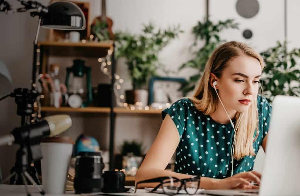 woman sitting at computer, focusing