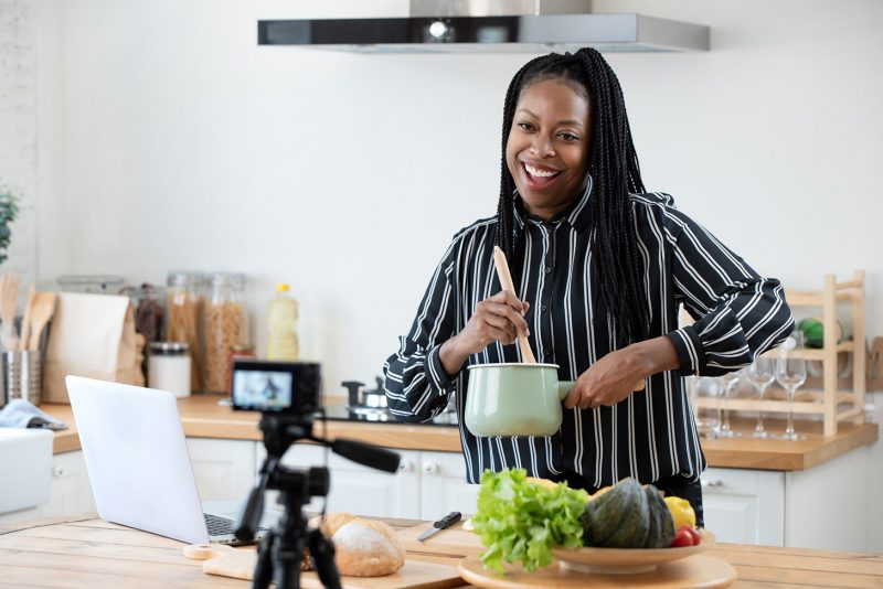 food blogger cooking in front of camera