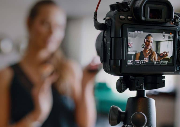 woman filming a video on a DSLR video camera