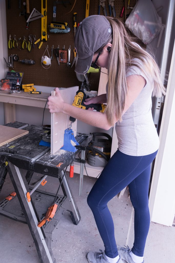 Brittany Goldwyn using power tools at a workbench for a diy.