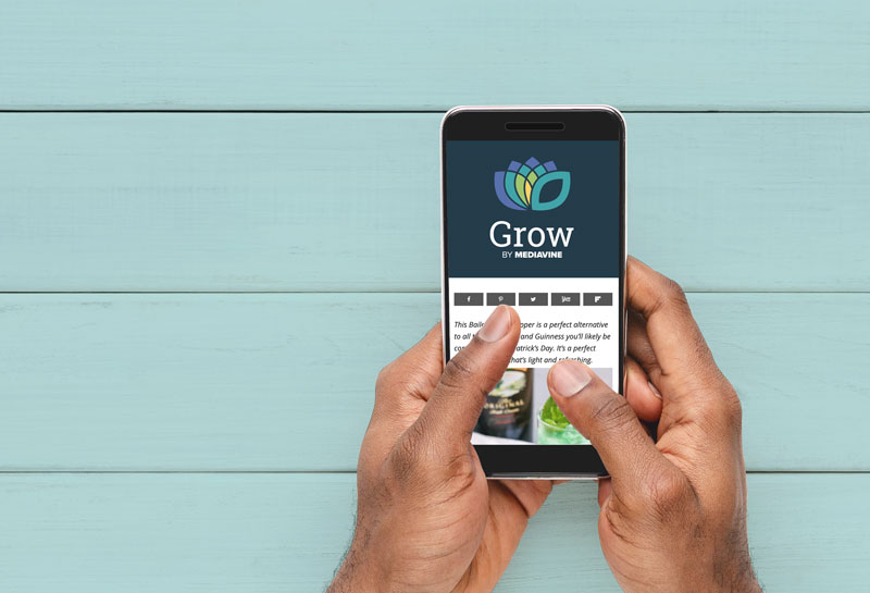 hands holding phone with grow logo and social icons
