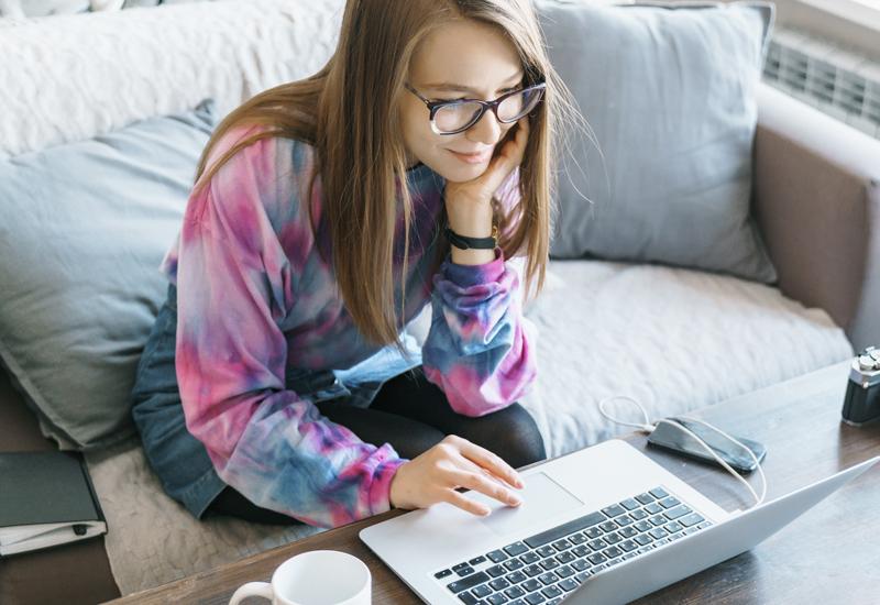 blogger using laptop smiling