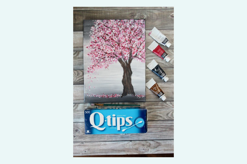 feeling nifty using Qtips to paint a cherry blossom tree