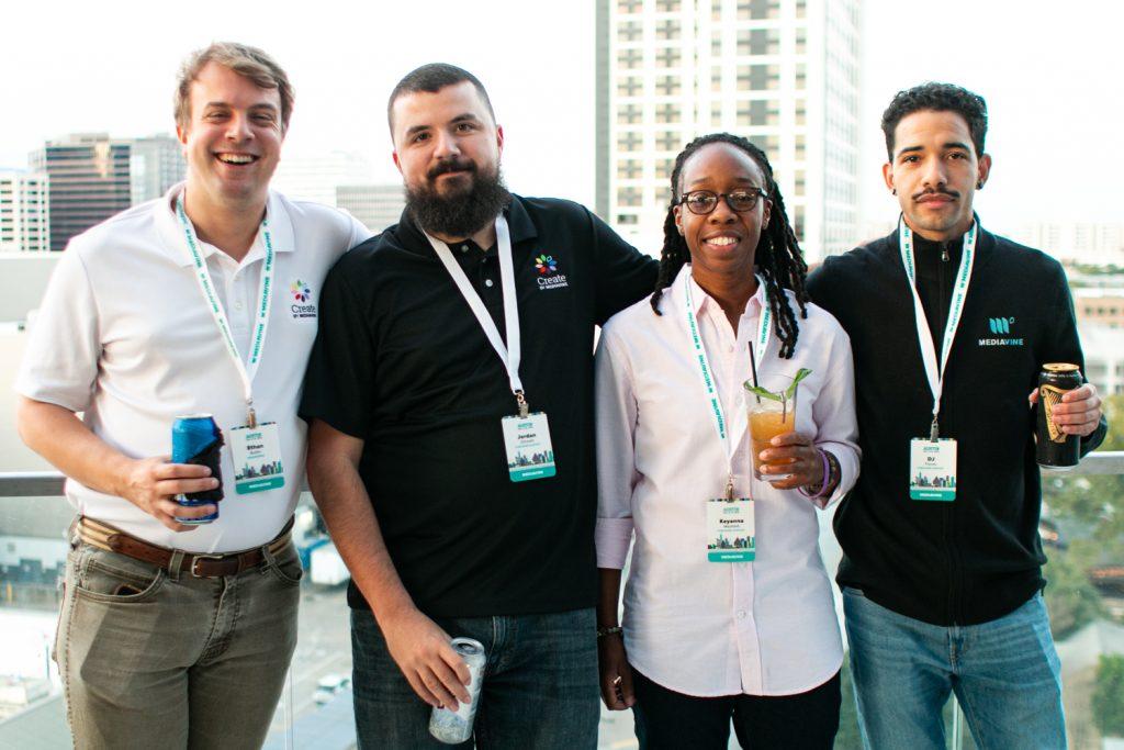 4 mediavine employees standing on a balcony