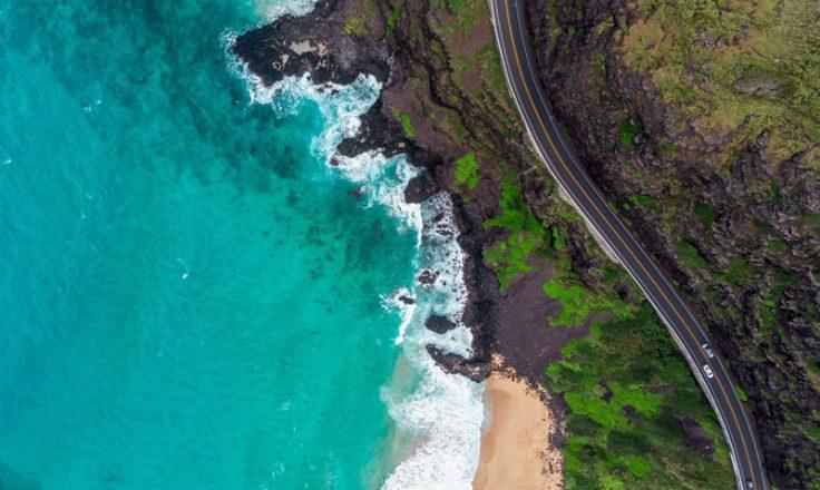 aerial view of ocean and winding road